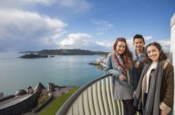Plymouth University Students in front of the sea