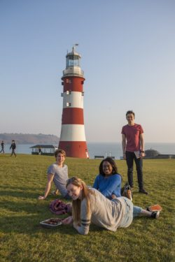 Students at the sea in Plymouth