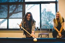 Mount Mercy University students playing pool