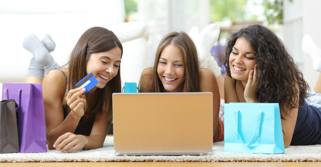 International students making online purchase with credit card