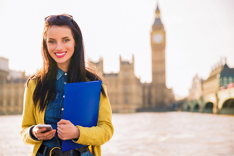 Student in front of Thames in London